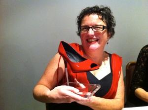 Winning grin with stiletto trophy. Photo: Eveylyn Tsitas